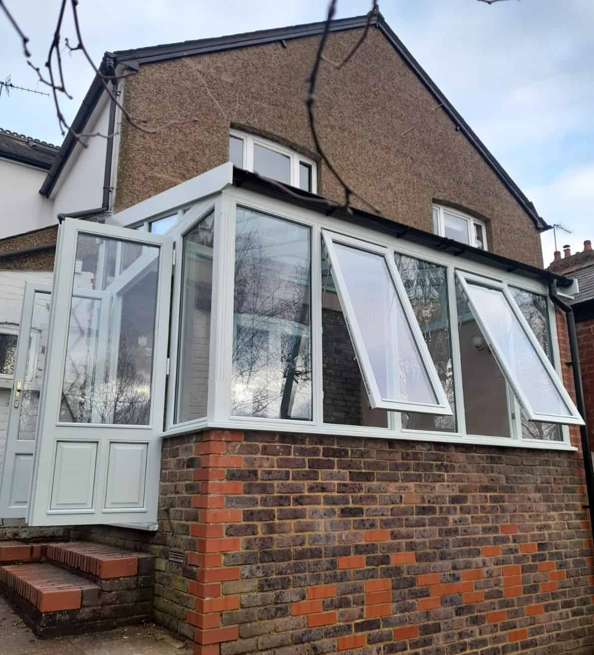 Hardwood Conservatory factory spray finished in Satin White.